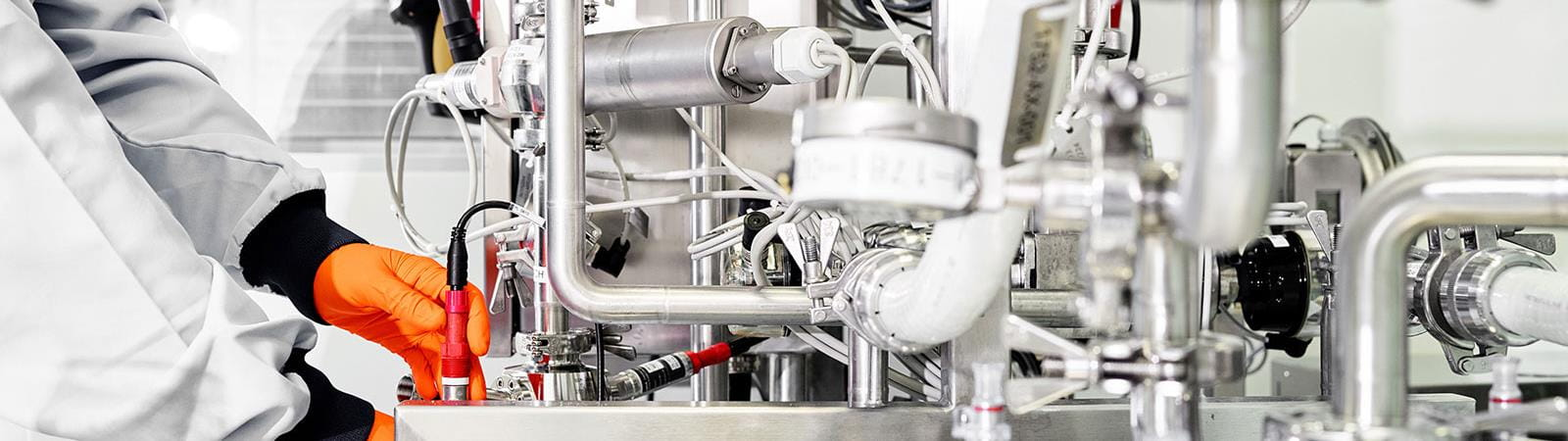 Bern manufacturing employee adjusting settings tank